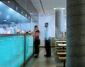 WAGAMAMA RESTAURANT, SOUTHBANK CENTRE, LONDON, SE1 SOUTHWARK + BERMONDSEY, UK, AUKETT TYTHERLEIGH, INTERIOR, KITCHEN WITH GLASS COUNTER