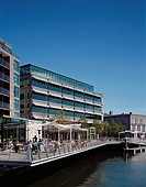 CLARION HOTEL AND CITY QUARTER OFFICES, LAPPS QUAY, CORK, IRELAND, SCOTT TALLON WALKER ARCHITECTS, EXTERIOR, OFFICE WITH RIVER COFFEE BARS