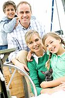 portrait of a family on a sailboat
