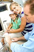 Family on a sailboat, smiling