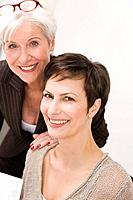 Two women smiling into camera
