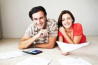 Couple work on home finance