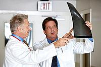 Two doctors looking at x_ray image in hospital