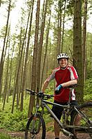 Male cyclist in forest portrait
