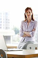 Woman with laptop in office portrait