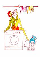 Young woman sitting on the washing machine