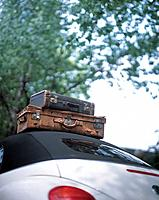 Old suitcases on top of the car