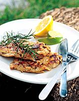 Grilled chicken and lemon on plate