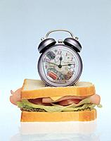 Alarm clock on a sandwich