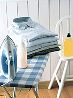Shirts and iron on an ironing board