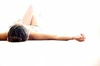 Woman indoors lying on floor