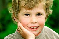 Blond, good looking child posing in a farm in Cambidge, New Zealand