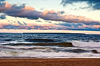 Morning skies over waves crashing on beach of Agawa Bay in Lake Superior, Canada