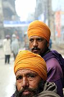 Early morning in Amritsar, Punjab,India  Sikh men sit on their cycle rickshaw waiting for their hot tea to be served