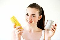 Woman holding corn and canned food