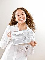 Hispanic woman holding gift