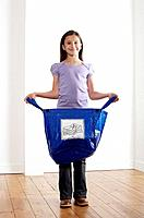 Girl holding a recycling plastic bag