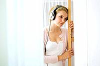 Girl listening to music on the headphones