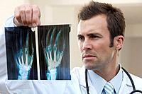 Male doctor looking at x_ray