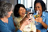 Multi_ethnic women toasting with wine