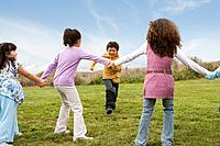 Multi_ethnic children playing game in field