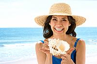 Hispanic woman holding seashell
