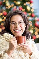 Hispanic woman holding coffee mug