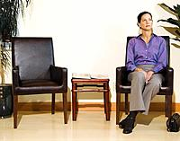 Mixed Race woman sitting in waiting area