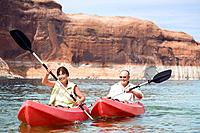 Multi_ethnic senior couple kayaking