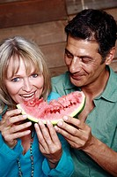 Mature adult couple with watermelon