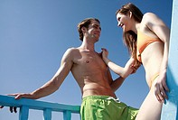 Young adult couple on beach (thumbnail)