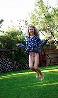 Girl jumping rope on grass (thumbnail)