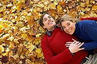 Couple lying down in leaves