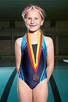 Girl with third place medal