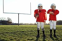 Boys dressed in football uniforms