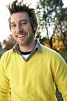 Friendly man wearing a yellow sweater