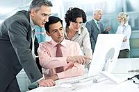 Co_workers looking at computer