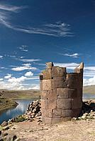 Peru, Sillustani, an old funerary tower called a Chullpas, lake in background