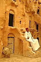 Tunisia, Tataouine, Ksar Ouled Soltane, fortified grainary, Tunisian caretaker of old site