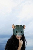 lady with rat mask, one finger on lips