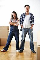 Couple standing in new apartment