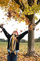 Girl throwing leaves