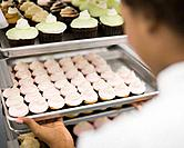 Baker Getting Cupcakes from Cooling Rack
