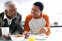Grandfather and Grandson Enjoying Breakfast