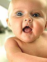 Baby with wide eyes and mouth open (thumbnail)