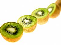 Row of Kiwi Fruit cut in half