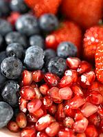 Strawberries blueberries and pomegranate seeds
