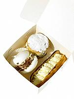 Cream Cakes in take out packaging