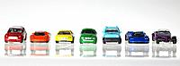 Seven coloured Model Cars in a row
