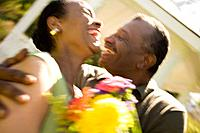 A couple with flowers outdoors (thumbnail)